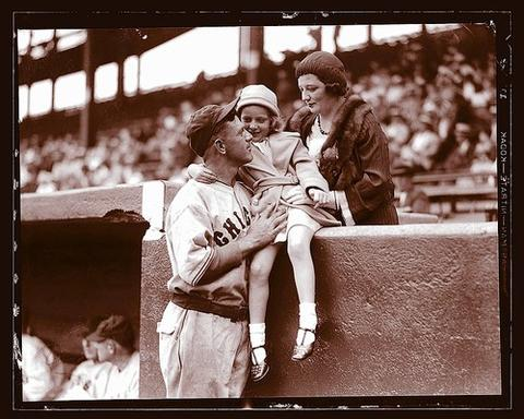 Cubs manager Charlie Grimm visits with his wife, Lillian, and daughter, Mae Gene, before a 1932 game at Wrigley Field.