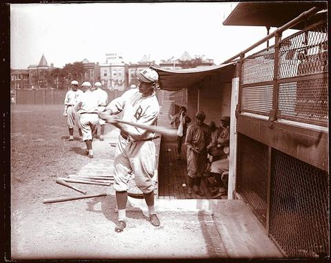 Zach Wheat warms up at Cubs Park, as Wrigley Field was once called, and strikes a serious pose at the ballpark in 1926. A line-drive hitter, Wheat spent 18 of his 19 major-league seasons playing left field for Brooklyn. He retired after the 1927 season with a .317 lifetime average and almost 2,900 hits.