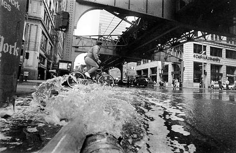 Water is pumped from the basement of the DePaul University building on South Wabash Avenue into the street.
