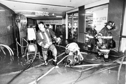 Members of the Chicago Fire Department respond to massive flooding in the lower concourse of the Thompson Center (then known as the State of Illinois Building.) The flooding occured in dozens of underground areas in downtown Chicago, after a century-old freight tunnel was punctured, causing water from the Chicago River to rush into buildings connected to the tunnel.