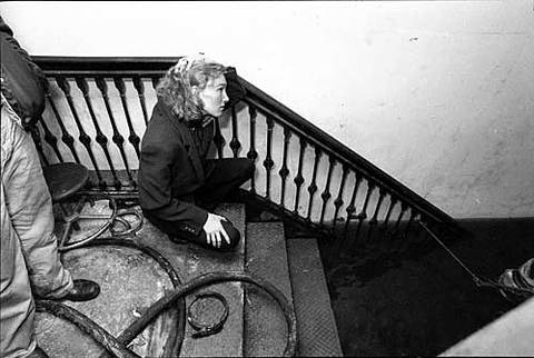 Marshall Field's employee Cathy Hoffman looks down into the water of the flooded third basement at the downtown State Street store.