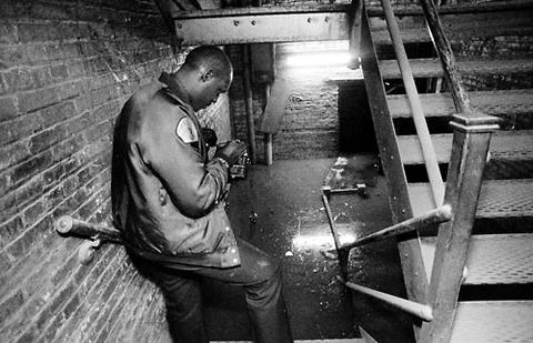 Chicago Fire Department photographer Art Harris takes pictures of the flooded second level of the sub-basement at the Merchandise Mart.