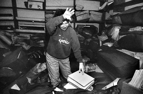 Cook County employee Mary Griffin helps sort through a basement full of records damaged by flood waters in the County Building at 118 North Clark Street.