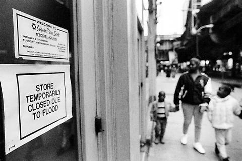A sign posted on the window at Carson Pirie Scott's State Street store lets pedestrians know that they're closed for business due to the basement flooding which plagued downtown buildings in Chicago.