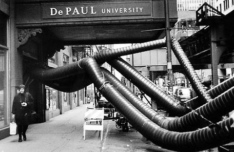 Dehumidifiers snake out of DePaul University's Loop building at Jackson Boulevard and Wabash Avenue. The dehumidifiers were deployed to remove moisture from the air in the building's flooded basements.