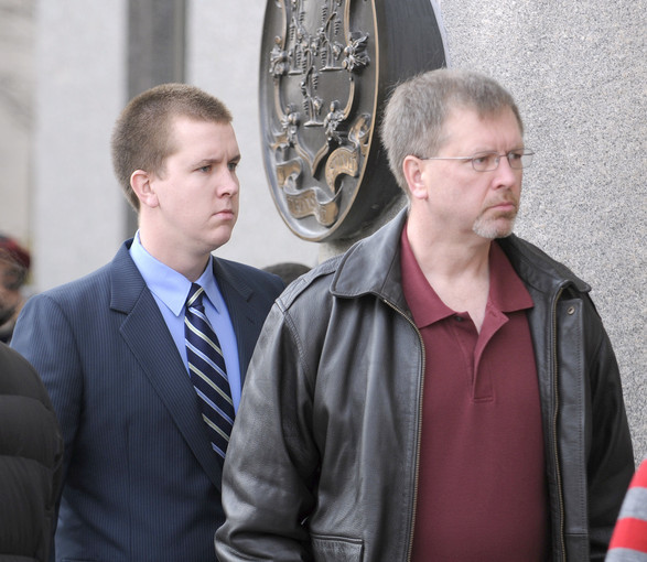 Windsor Locks police officer Michael Koistenen, left, arrived at Hartford Superior Court Tuesday morning with his father Windsor Locks police Sgt. Robert Koistenen for Michael's arraignment in the death of pedestrian Henry Dang.