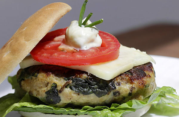 The change-up: Chicken fills in nicely for beef in this chicken, spinach and chive grilled burger.