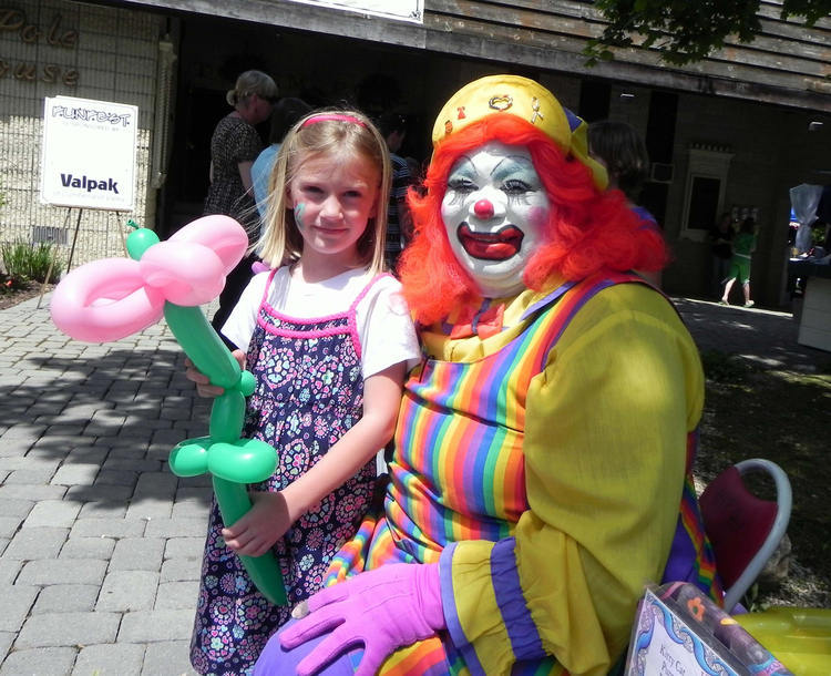 Ashlyn Price of Biglerville, Pa., gets a balloon flower from Hip Hop, one of the clowns on hand Saturday at Fun Fest 2011 at Totem Pole Playhouse in Fayetteville, Pa.