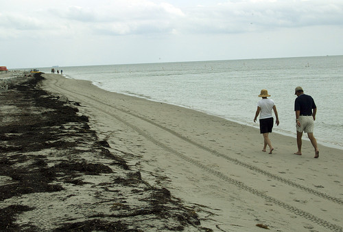 "Beach goers walk along the waters edge at Bill Baggs Cape Florida State Park, in Key Biscayne, Fla. Cape Florida State Park is on the list of Top 10 Beaches produced annually by coastal expert Stephen P. Leatherman, also known as ""Dr. Beach,"" director of Florida International University's Laboratory for Coastal Research."
