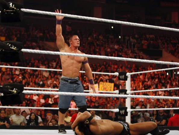 "John Cena celebrates his win during ""Monday Night Raw"" at the Staples Center in Los Angeles, August 16, 2010."