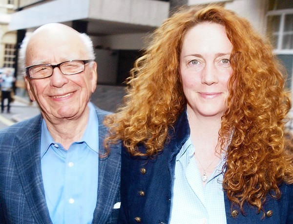 "Rupert Murdoch, left, chairman of News Corporation-- shown with Rebekah Brooks, one of his former executives -- seemed pretty casual about throwing his deputies under the bus in front of the British Parliament, blaming ""the people I trusted. And the people they trusted"" for the phone-hacking scandal."
