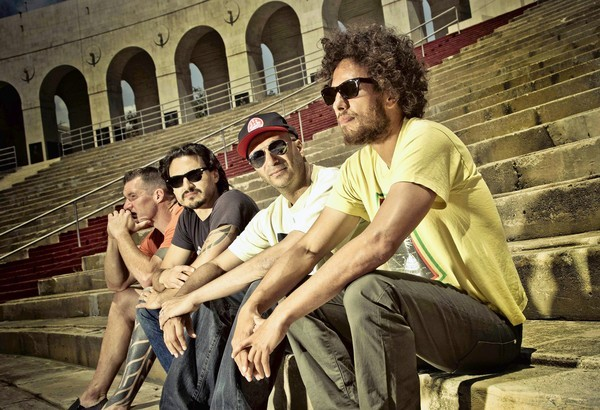 POLITICS AND ROCK: Tim Commerford, left, Brad Wilk, Tom Morello and Zack de la Rocha are headlining the L.A. Rising festival at the Coliseum.