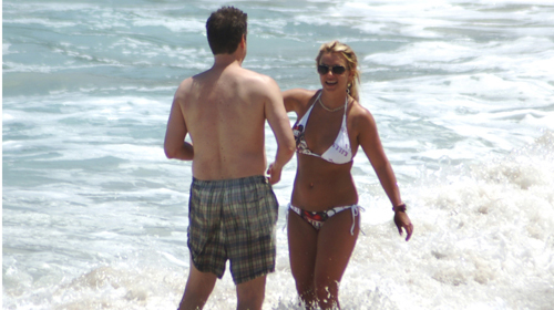 Britney Spears stands in the surf with an unidentified man on Barrigona Beach in Guanacaste Provience of Costa Rica.