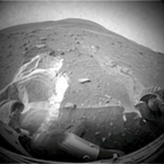 A view from Spirit, which has been stuck since April. Scientists say the fluffy, loose soil and a small rock under the robot could be problems for the rescue.
