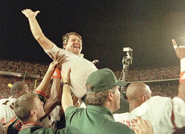 University of Miami football coach Jimmy Johnson is carried from the field by his players after the Hurricanes defeated the Oklahoma 20-14 in the Orange Bowl Classic