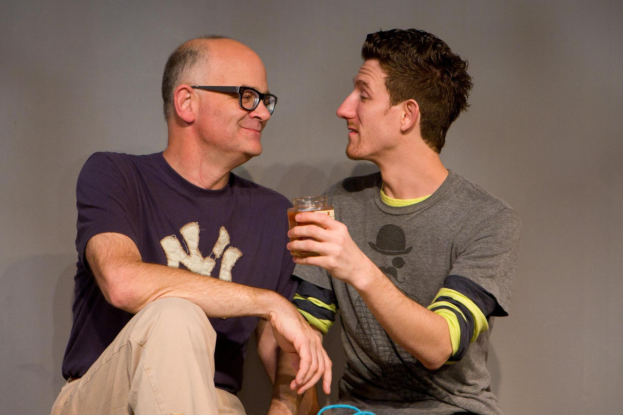 Thomas Ouellette (left) and Christopher McIntyre are mismatched lovers who clash over faith in 'Next Fall.'