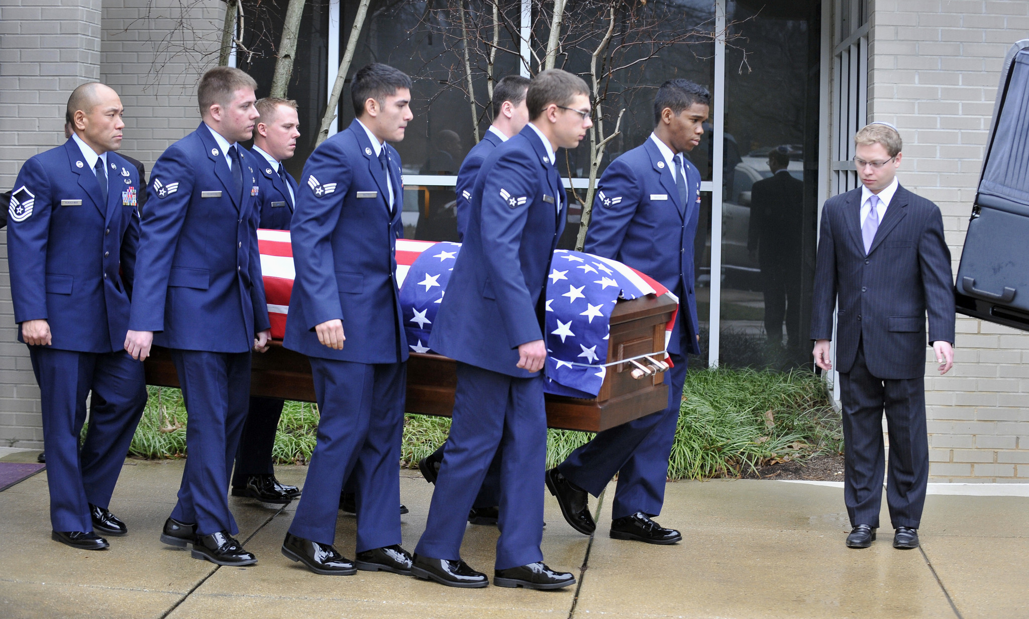 Pallbearers carry the flag-covered casket at the funeral for Airman 1st Class Matthew Ryan Seidler who was killed in Afghanistan. The services were held at Sol Levinson & Bros. funeral home in Pikesville.
