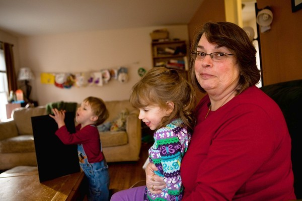 Aleta Stoler, 57, plays with her grandchildren Miriam, 4, and Asher Froebe, 2, at home in Flossmoor on Wednesday. Stoler is a cancer survivor who has participated in the Komen three-day fundraising walk and is upset about its decision to pull out funding from Planned Parenthood.