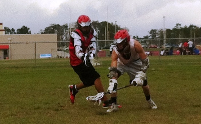 East River midfielder Joey Klawe-Genao, left, mixes it up with teammate Robert Mosher during a recent practice.