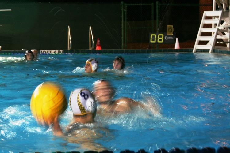 University junior Martin Penalba pump fakes Edgewater's defense at the 4-meter line.