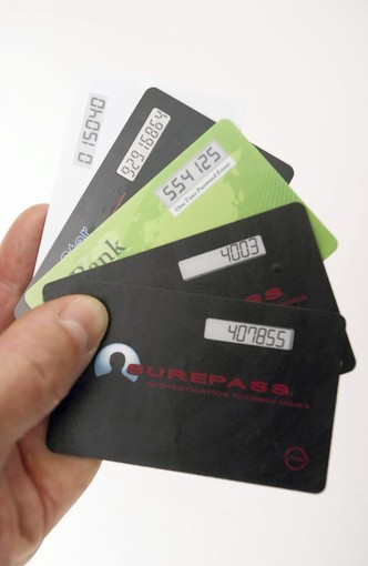 Mark Poidomani shows one-time password cards.
