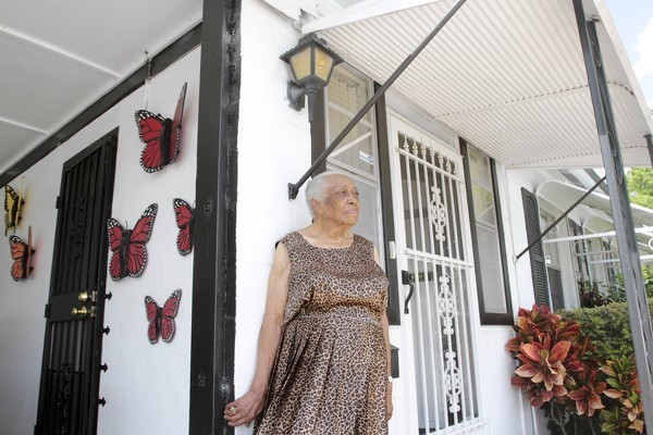"Thelma Montgomery bought her house in Washington Shores in 1947. ""This is an old community, and it's a good community,"" she said."