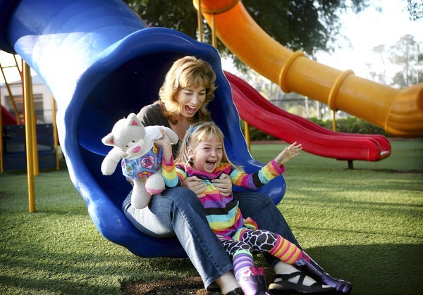 Sadie Veselka, 7, and mom Dawn play recently at an Oviedo park. Since Sadie's juvenile-arthritis diagnosis, they have gone to Gainesville for treatment. Soon, she can get treated at Nemours.