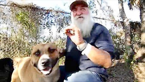 An Orange County homeless man named Russell, who is better known on the streets as Santa Claus, and his dog, Misdemeanor.