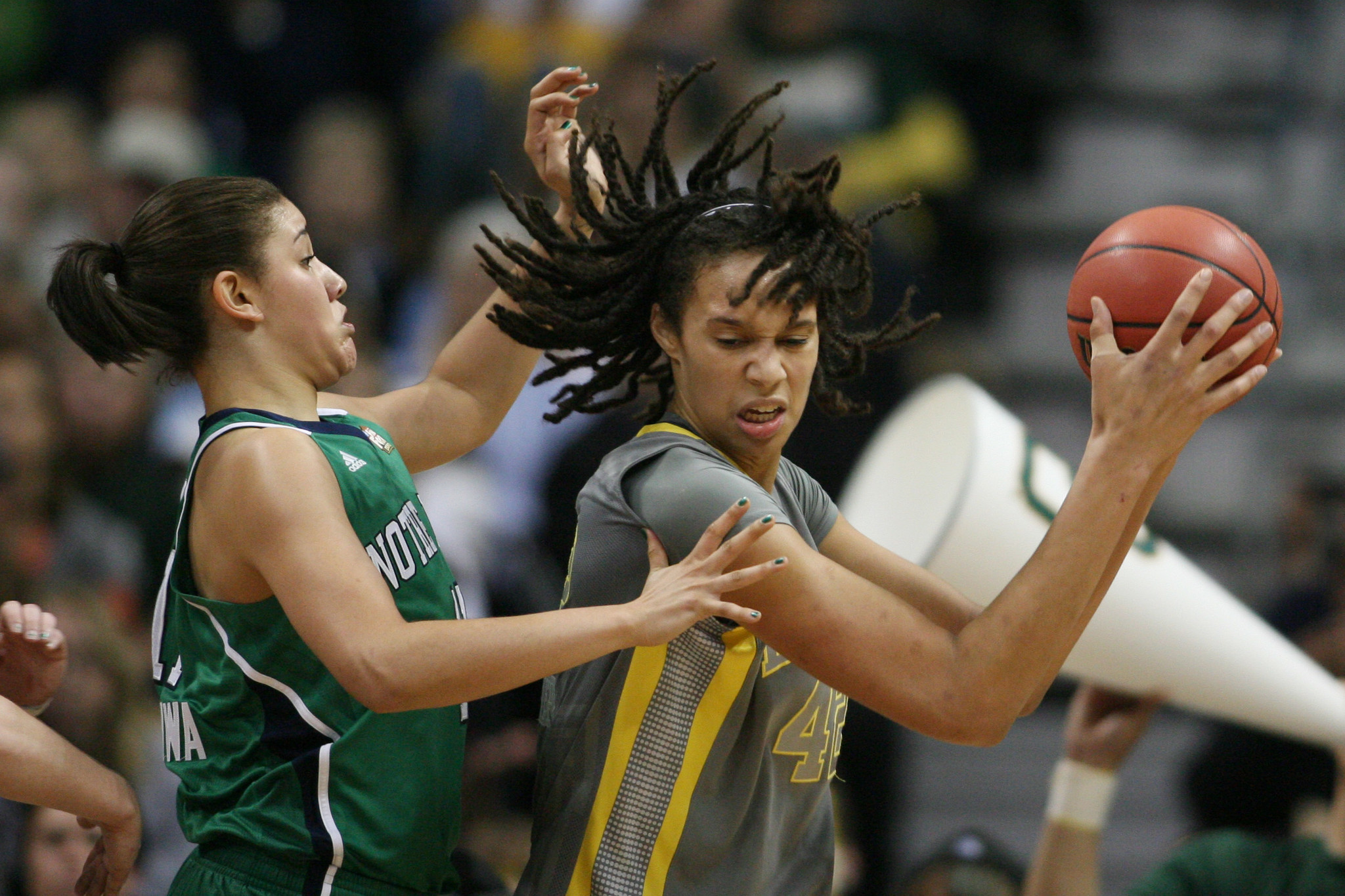 Baylor's Brittney Griner, right, protects the ball as Notre Dame's Natalie Achonwa defends.