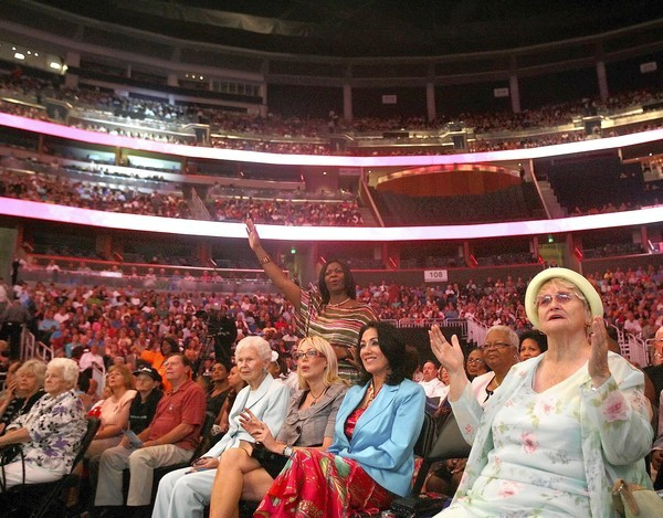 Thousands worship during a joint Easter church service with members of The First Baptist Church of Orlando and The Hope Church on Sunday at the Amway Center.