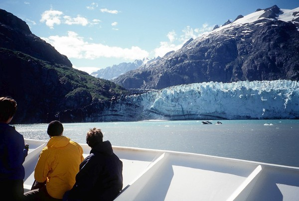 Views on a cruise in Alaska aboard the Yorktown Clipper. Yorktown Clipper passengers admire the glaciers of Glacier Bay National Park as the ship constantly circles to allow everyone an ideal view.