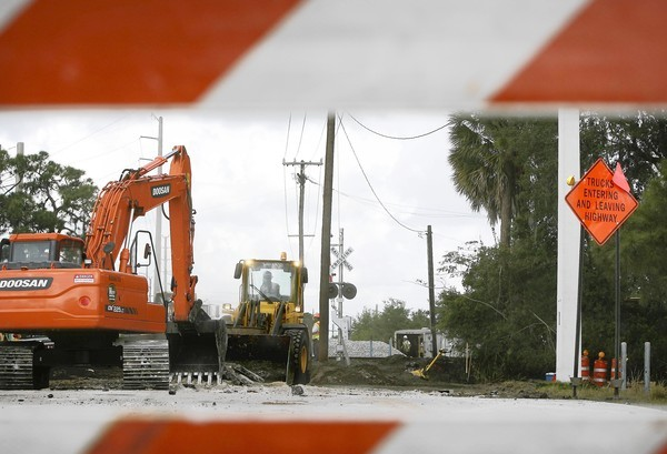Construction crews work near the railroad tracks on Thursday near Barwick Road and C.R. Beall Boulevard (US 17-92) in DeBary.