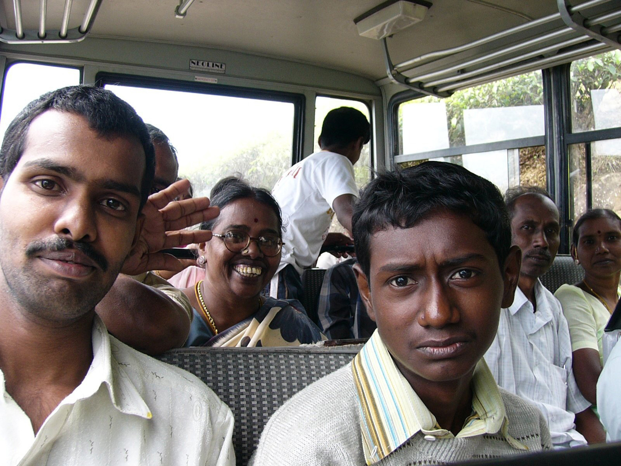 Locals in Southern India share their bus with foreign travelers. One can save money, and find adventure, by riding buses on foreign trips.