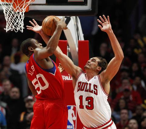 Chicago Bulls center Joakim Noah (13) defends against Philadelphia 76ers power forward Lavoy Allen (50) during the first half.