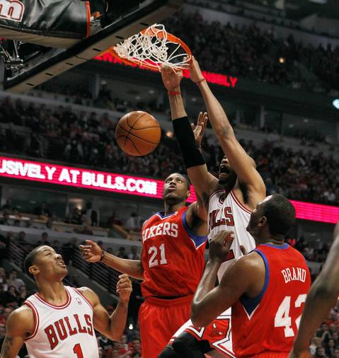 Chicago Bulls forward Taj Gibson (22) dunks against the Philadelphia 76ers during the first half.