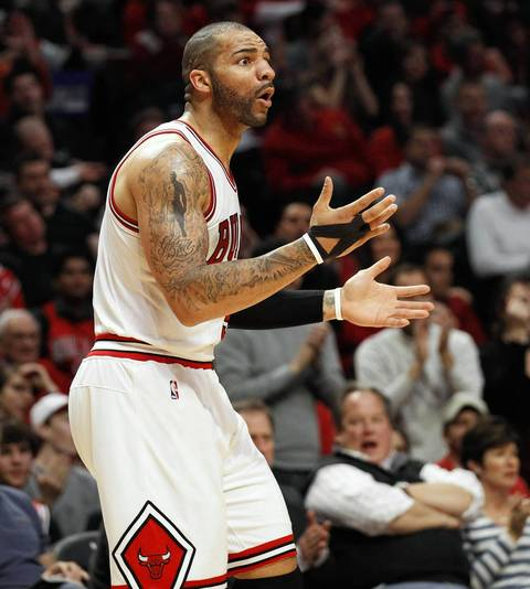 Chicago Bulls power forward Carlos Boozer (5) reacts after being called for traveling during the first half.