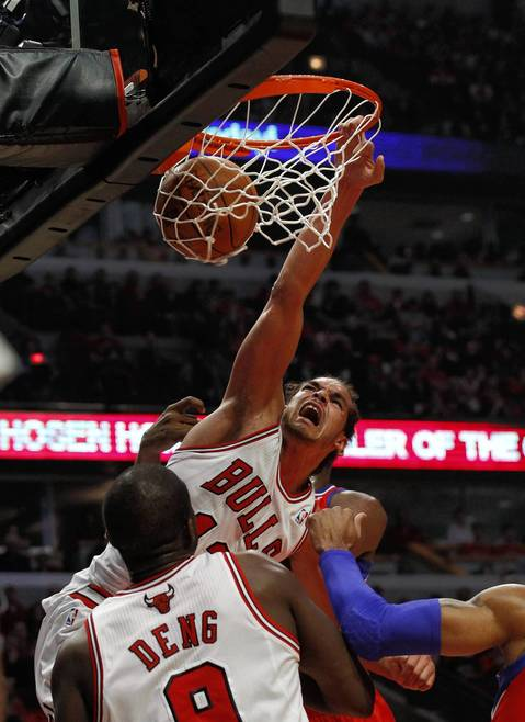 Chicago Bulls center Joakim Noah (13) dunks against the Philadelphia 76ers during the first half of their game one of Eastern Conference Playoffs at the United Center, in Chicago.