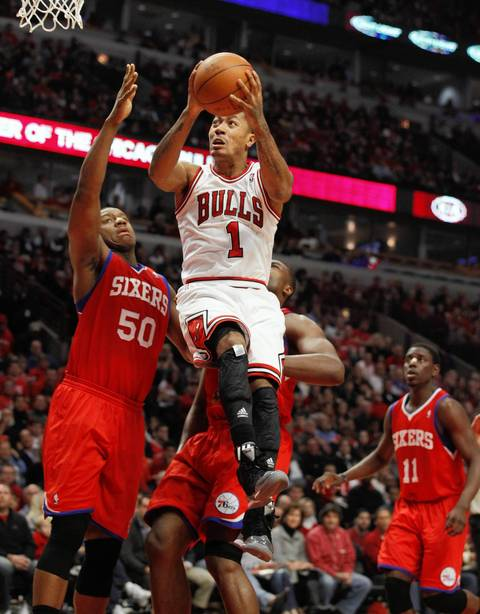 Chicago Bulls point guard Derrick Rose (1) drives to the basket against Philadelphia 76ers power forward Lavoy Allen (50) during the first half