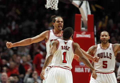 Chicago Bulls center Joakim Noah (13) celebrates with Chicago Bulls point guard Derrick Rose (1) after a basket against the Philadelphia 76ers during the second half.