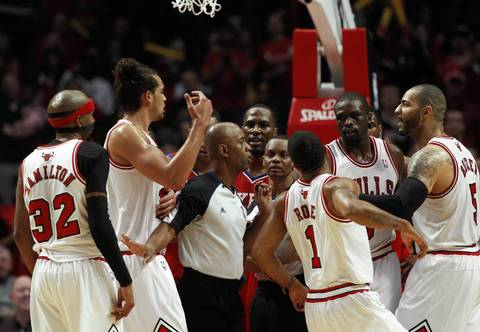 Chicago Bulls players during a scuffle with Philadelphia 76ers players during the second half.