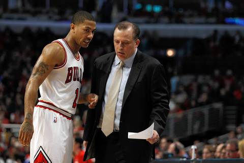 Chicago Bulls point guard Derrick Rose (1) with coach Tom Thibodeau late in the game.