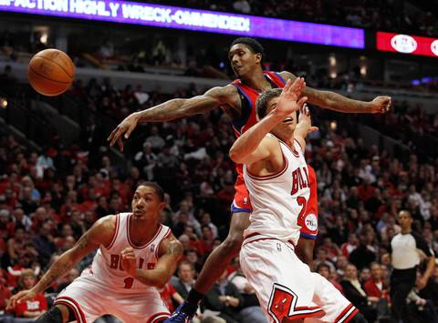 Chicago Bulls point guard Derrick Rose (1) and right, Chicago Bulls small forward Kyle Korver (26) defend against Philadelphia 76ers point guard Lou Williams (23) during the second half.