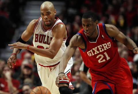 Philadelphia 76ers forward Thaddeus Young (21) steals the ball away from Chicago Bulls forward Taj Gibson (22) during the second half.