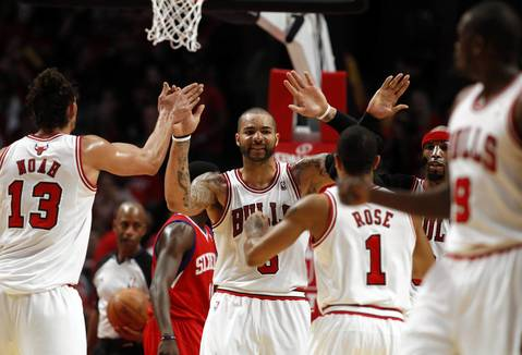 Chicago Bulls power forward Carlos Boozer (5) celebrates with his teammates during the second half.