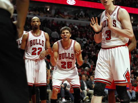 Chicago Bulls small forward Kyle Korver (26) reacts after being charged with a foul during the second half.