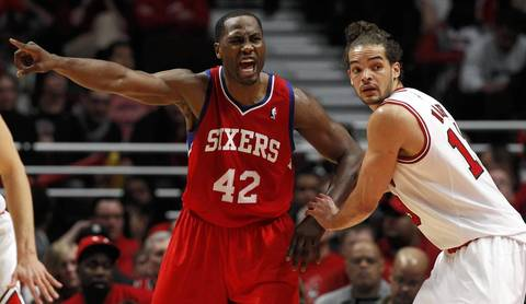 Philadelphia 76ers power forward Elton Brand (42) directs a teammate while being guarded by Chicago Bulls center Joakim Noah (13) during the first half.