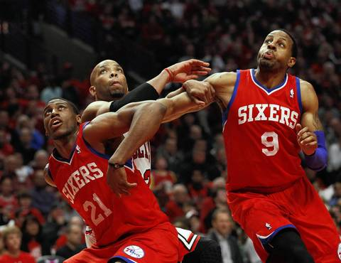 Philadelphia 76ers forward Thaddeus Young (21), Chicago Bulls forward Taj Gibson (22) and Philadelphia 76ers small forward Andre Iguodala (9) wait for a rebound.