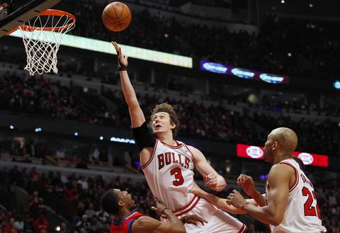 Chicago Bulls center Omer Asik (3) gets charged with an offensive foul against Philadelphia 76ers forward Thaddeus Young (21) during the first half.