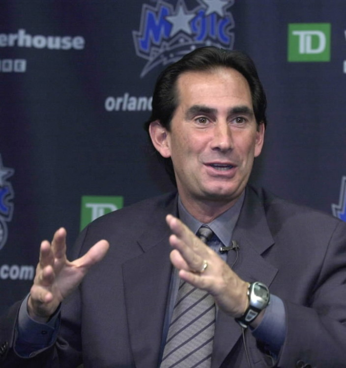 Orlando Magic's former General Manager John Gabriel fields questions at a news conference in Orlando in 2004. (Associated Press file)