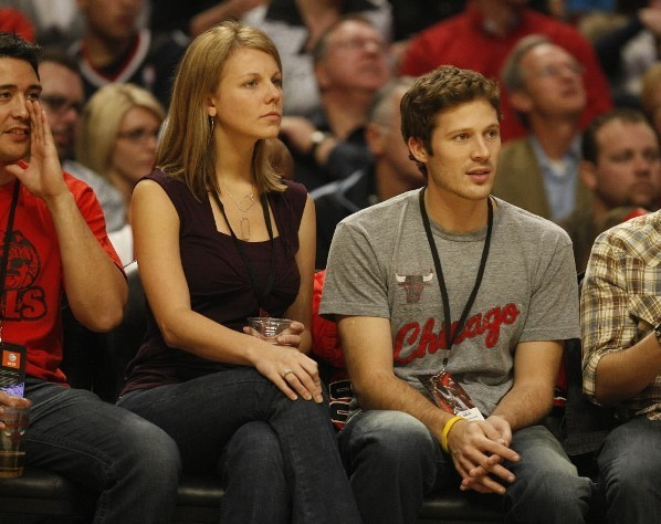 """Friday Night Lights"" star Zach Gilford (left) watches the Bulls-Charlotte Bobcats game with friends at the United Center November 7, 2009."